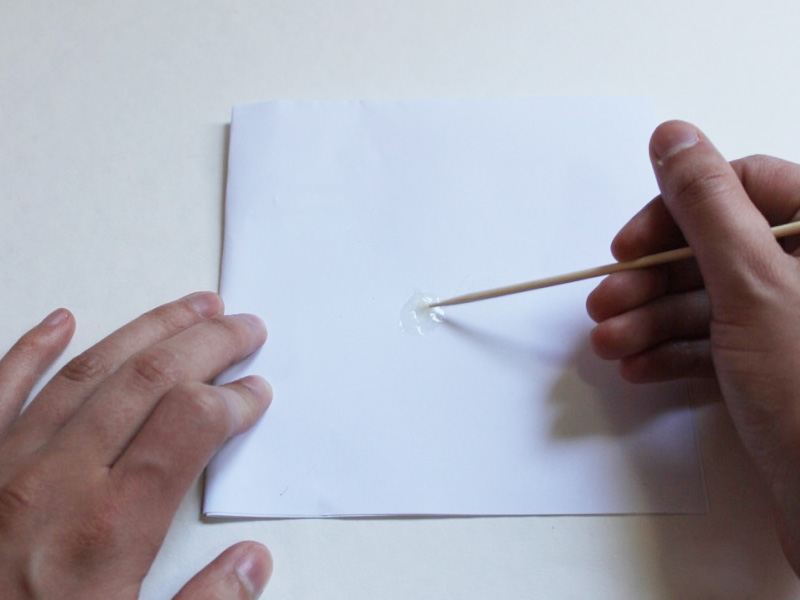Mixing the araldite glue onto a piece of paper