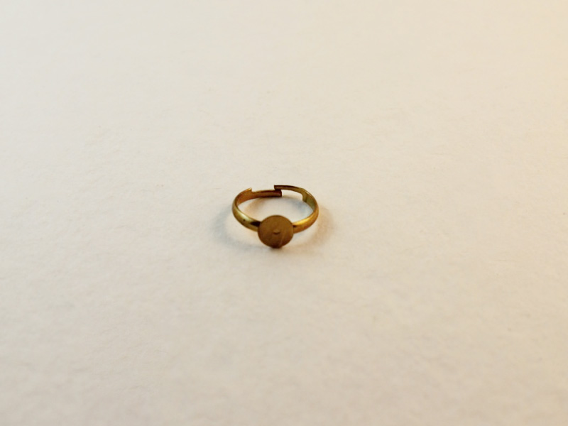 A gold colored metal ring finding.