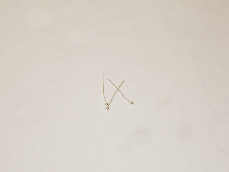 three small silver head pins