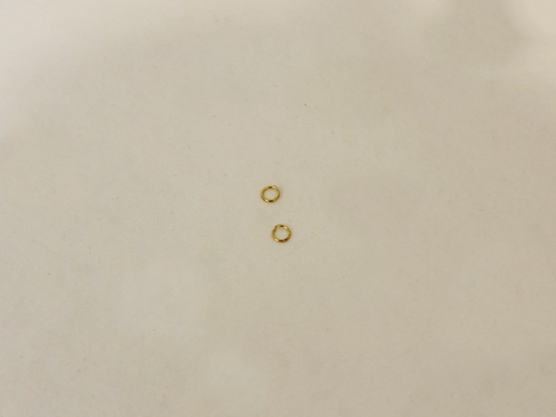 two gold colored jump rings
