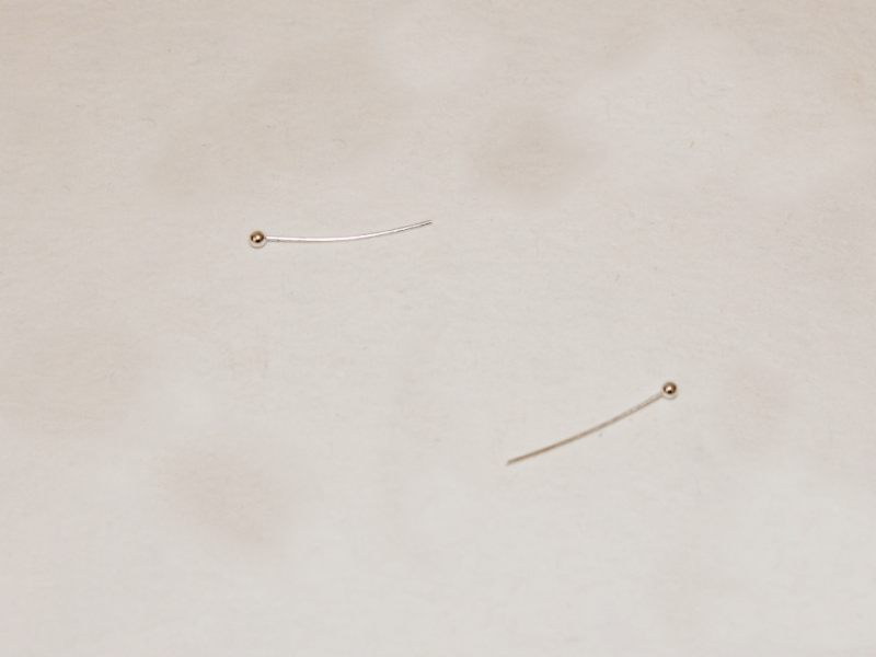Two small head pins featuring ball ends